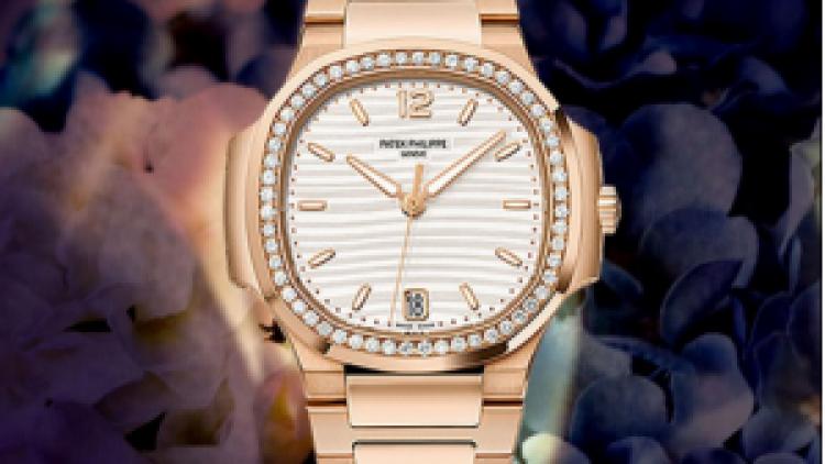 Replica Patek Philippe Ladies Nautilus Series rose gold diamond-studded replica watches  7118 / 1200R-001